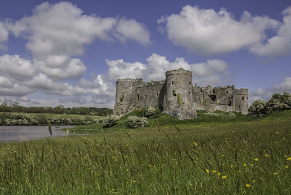 Carew Castle - a stone castle overlooking a Millpond