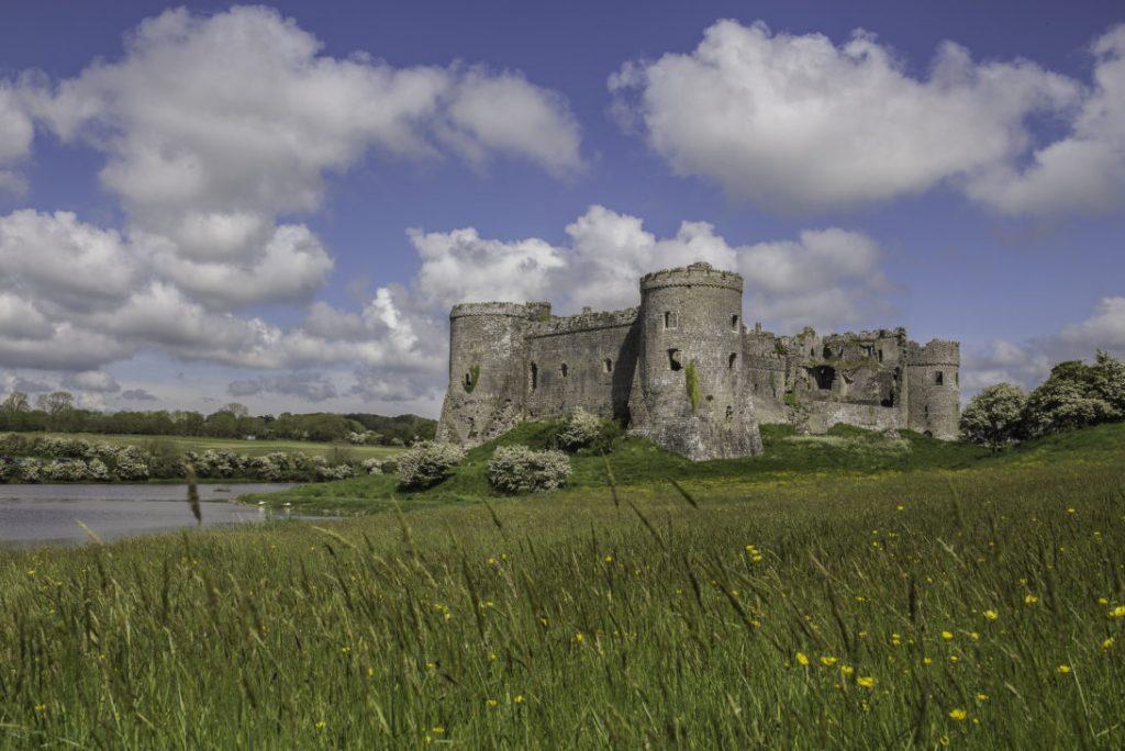 Carew Castle - a stone castle overlooking a Millpond