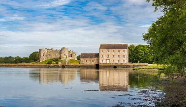 Carew Castle and Tidal Mill, overlooking a Millpond