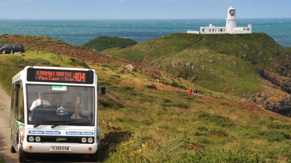 Minibus driving near the Strumble Head lighthouse