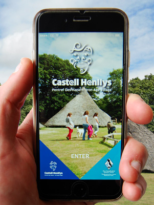 A smartphone with Castell Henllys app on screen