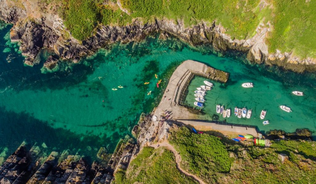 Kayakers at Porth Clais harbour near St Davids in the Pembrokeshire Coast National Park
