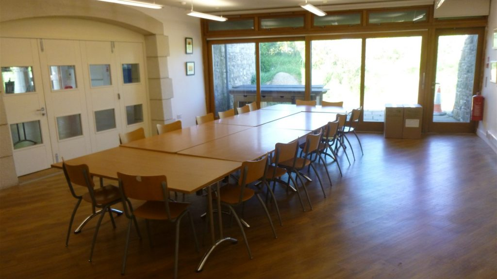Tables and chairs in the St Davids Room, Oriel y Parc