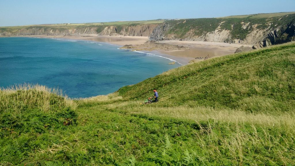 National Park Authority Warden using machine on Coast Path near Marloes Sands