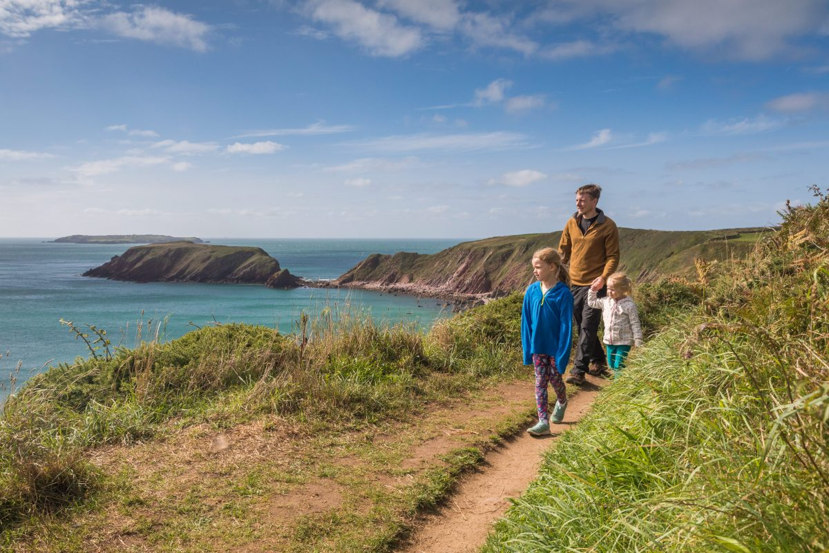 Family walking on Pembrokeshire Coast Path near Marloes
