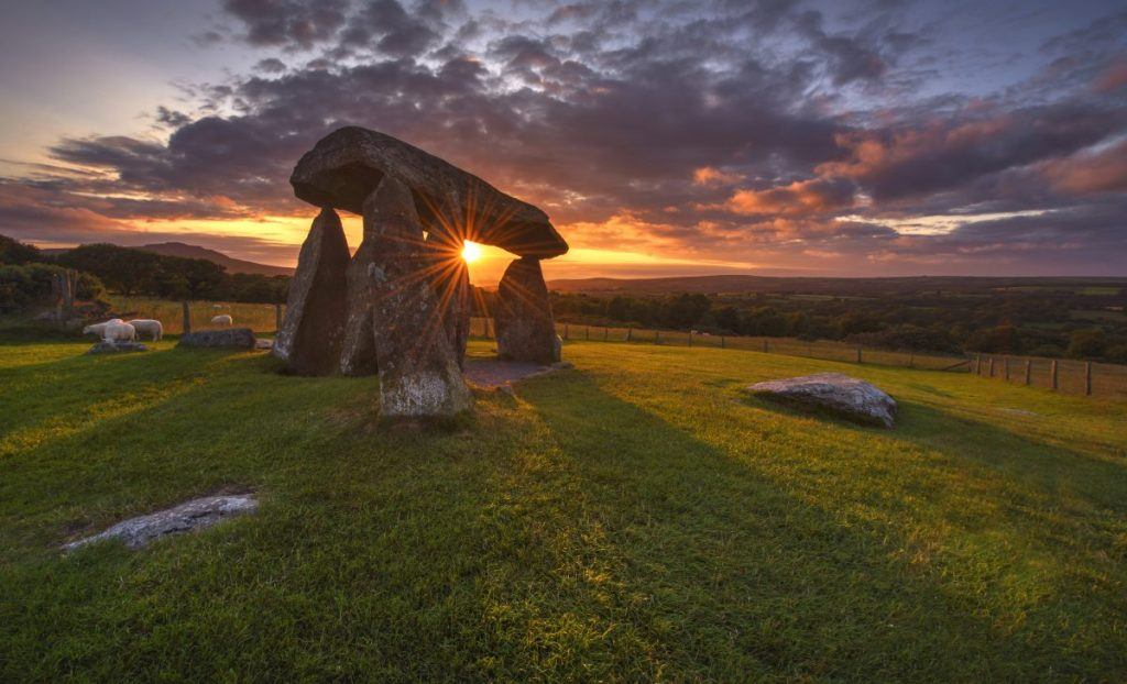 Colorful sunset over Pentre Ifan Burial chamber, Wales