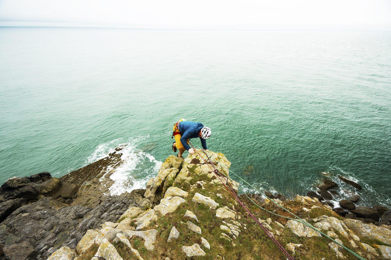Climber at St Govan's, Pembrokeshire Coast National Park, Wales, Uk