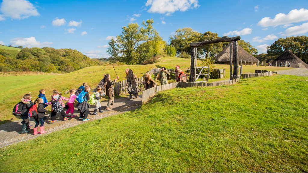 School group enter Castell Henllys Iron Age Village