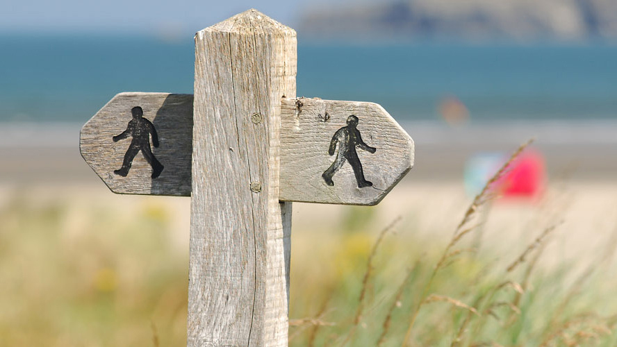 Footpath waymarker at Poppit Sands, Pembrokeshire Coast National Park, Wales, UK