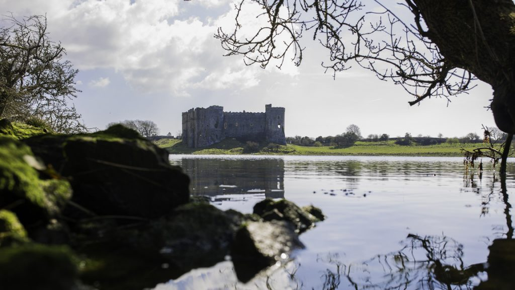 View across the Millpond to Carew Castle and Tidal Mill