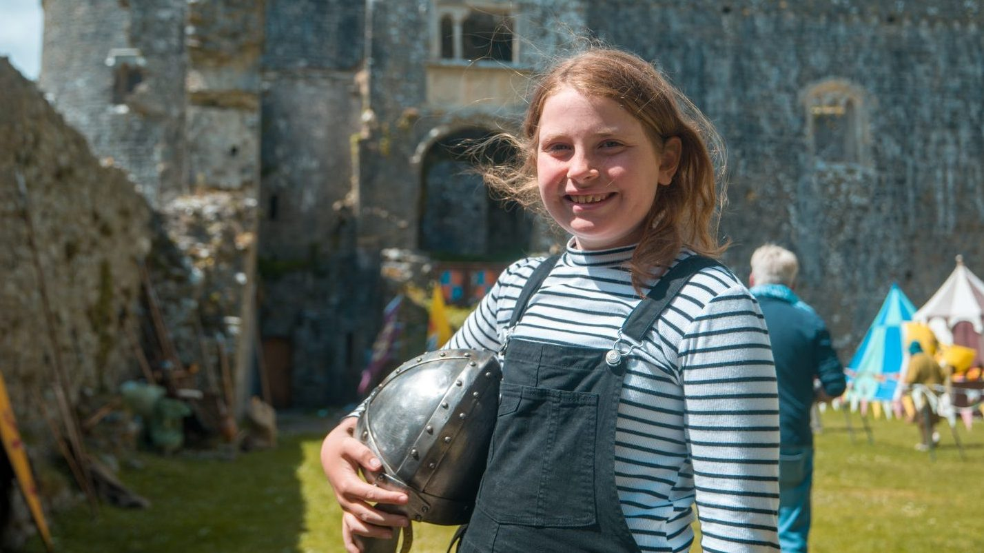 Smiling girl at Carew Castle