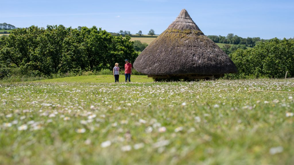 Two people walking at Castell Henllys
