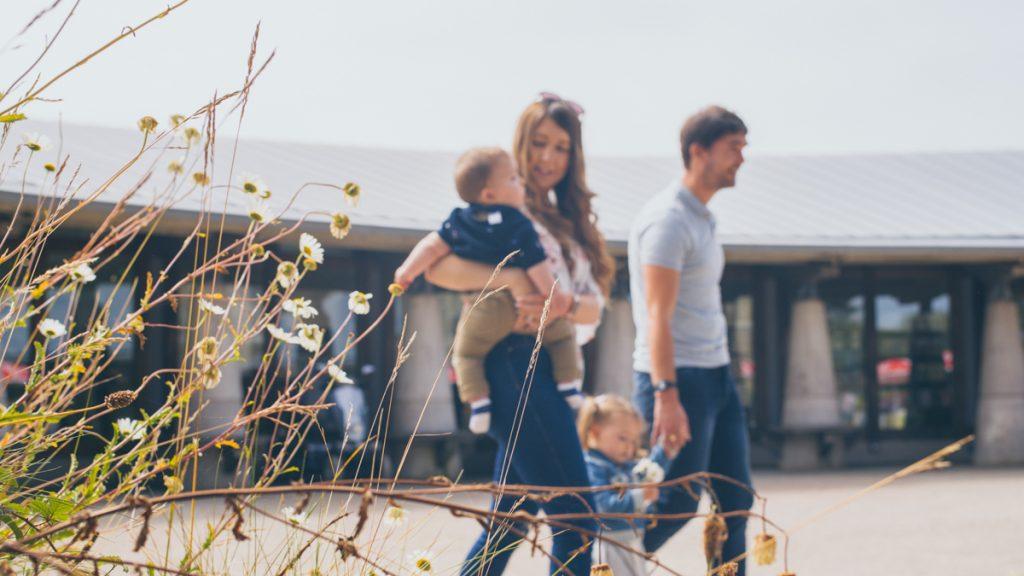 Family walking through Oriel y Parc courtyard