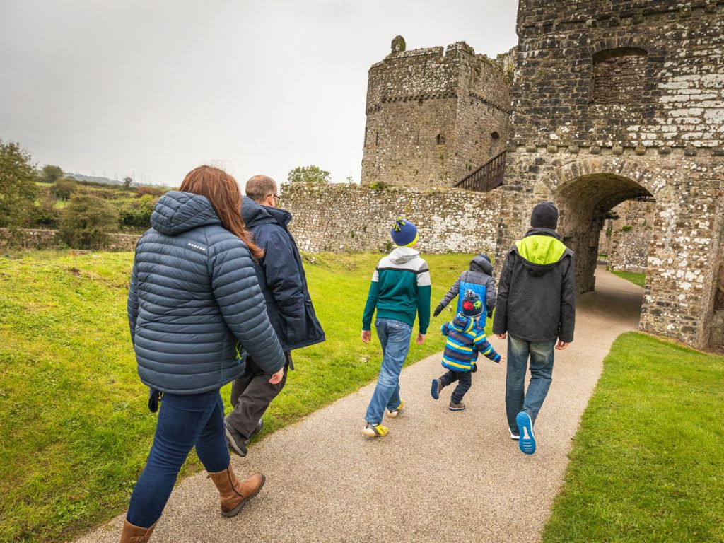 Family entering Carew Castle