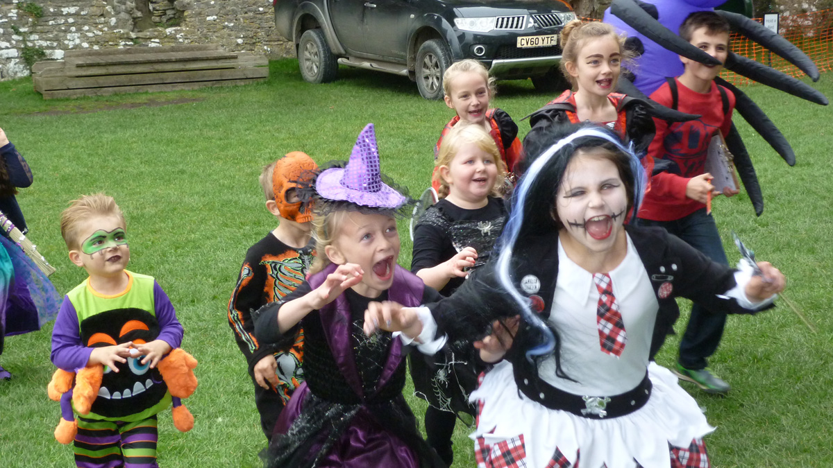 Children dressed in Halloween costumes at Carew Castle