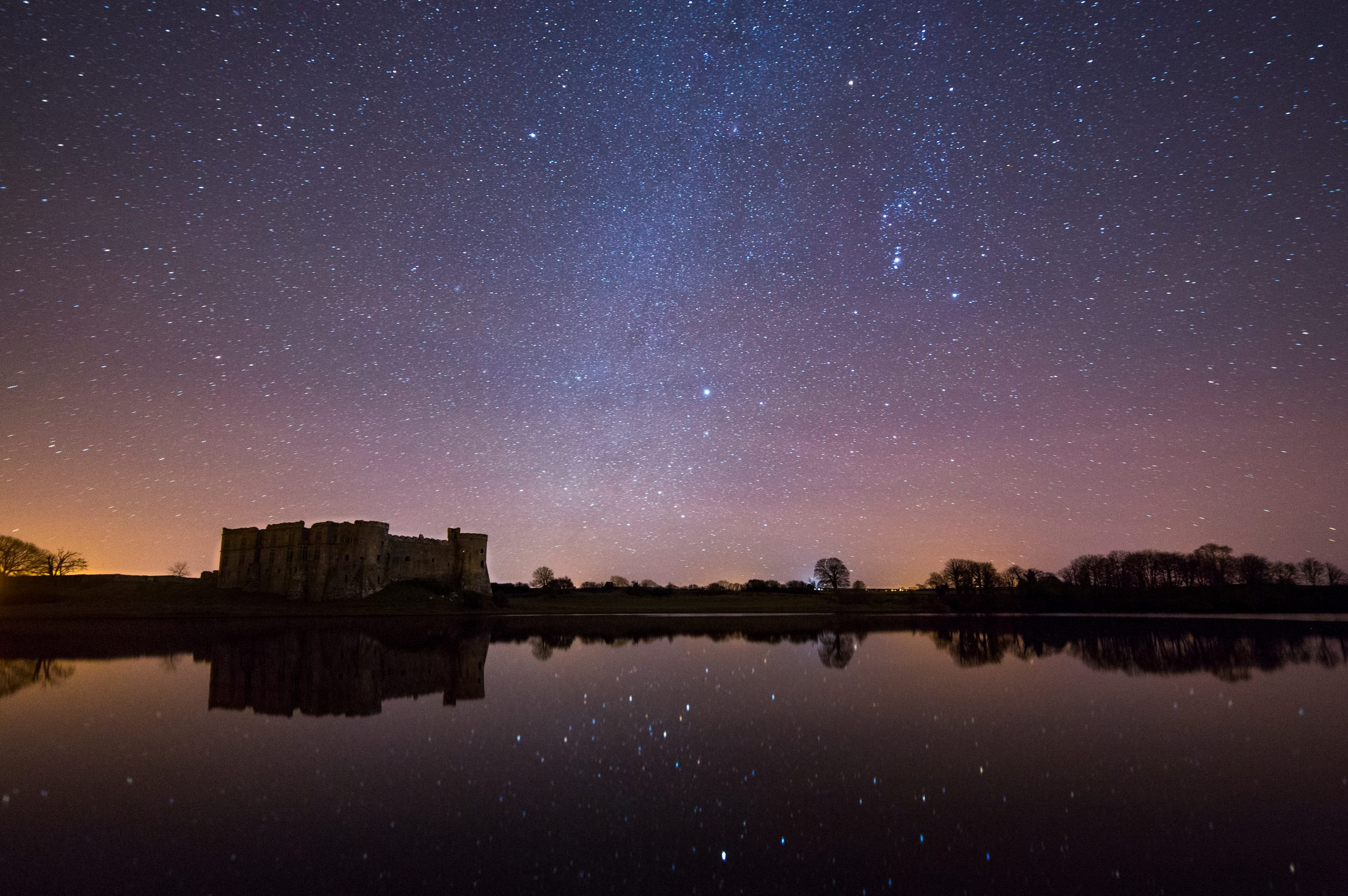 Starry skies above Carew Castle