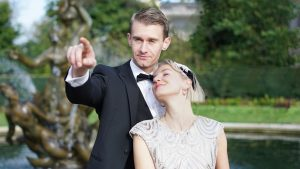 Man in a tuxedo and woman in 1920's flapper dress