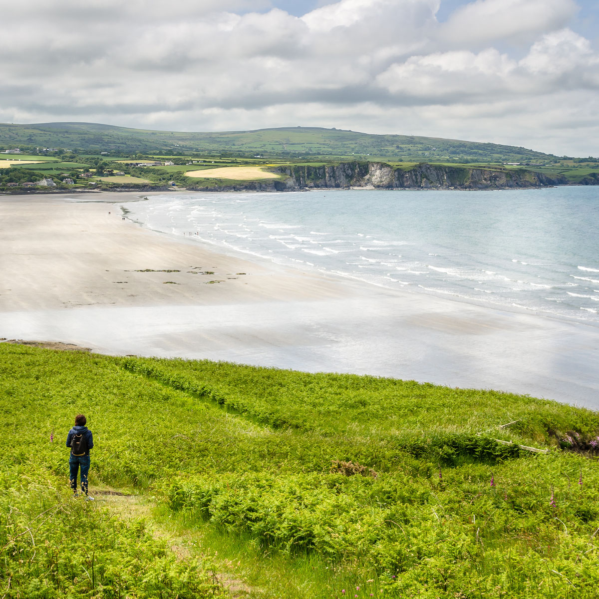 Young Woman Hiker on a Coastal Path in Wales