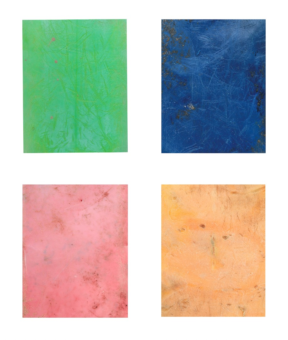 Photograph of four rectangular pieces taken from shipping containers, one green, one blue, one red and one orange