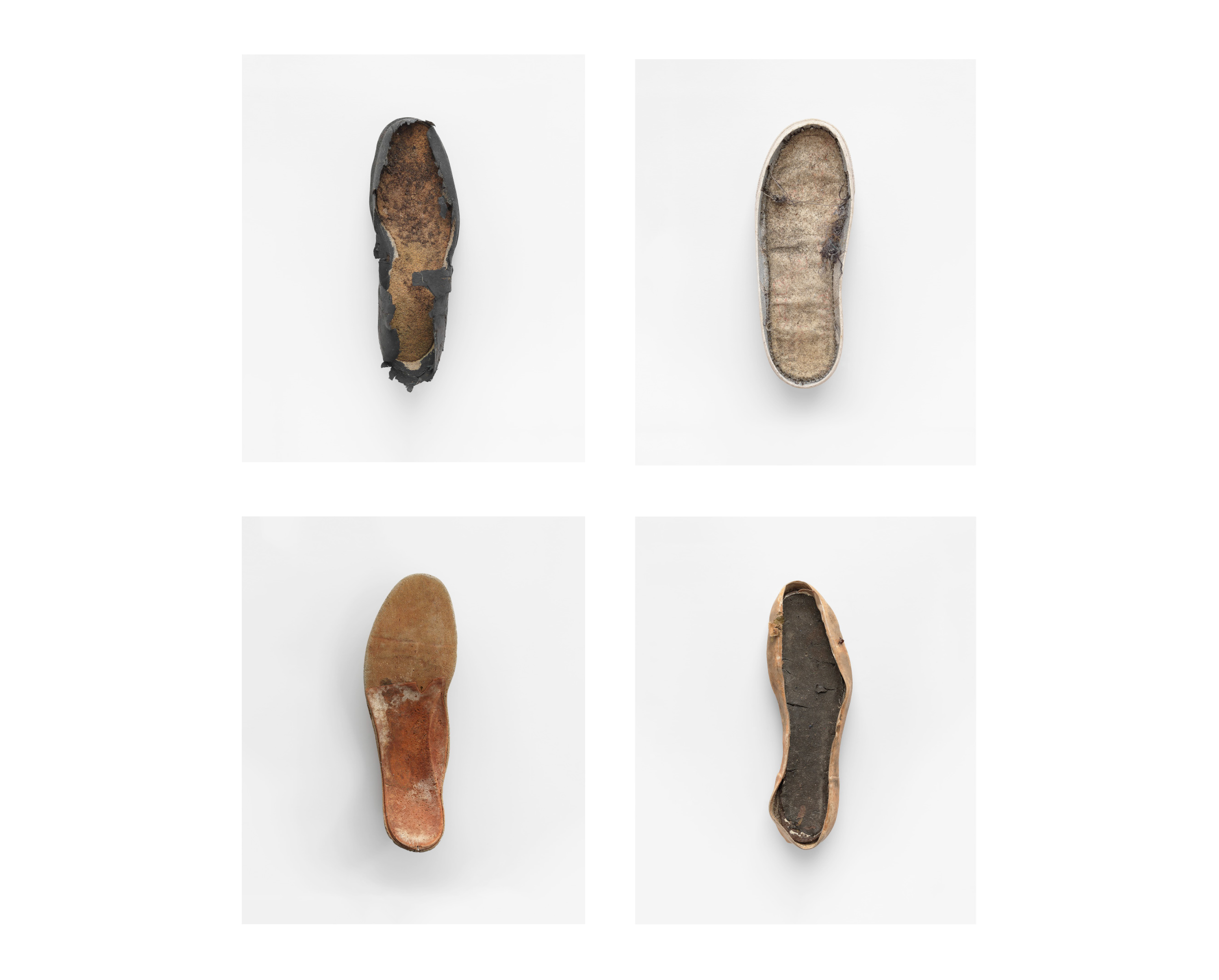 Photograph of four degraded shoe soles