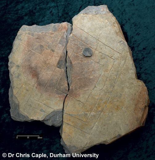 Scratches on a broken stone (Archaeological dig find