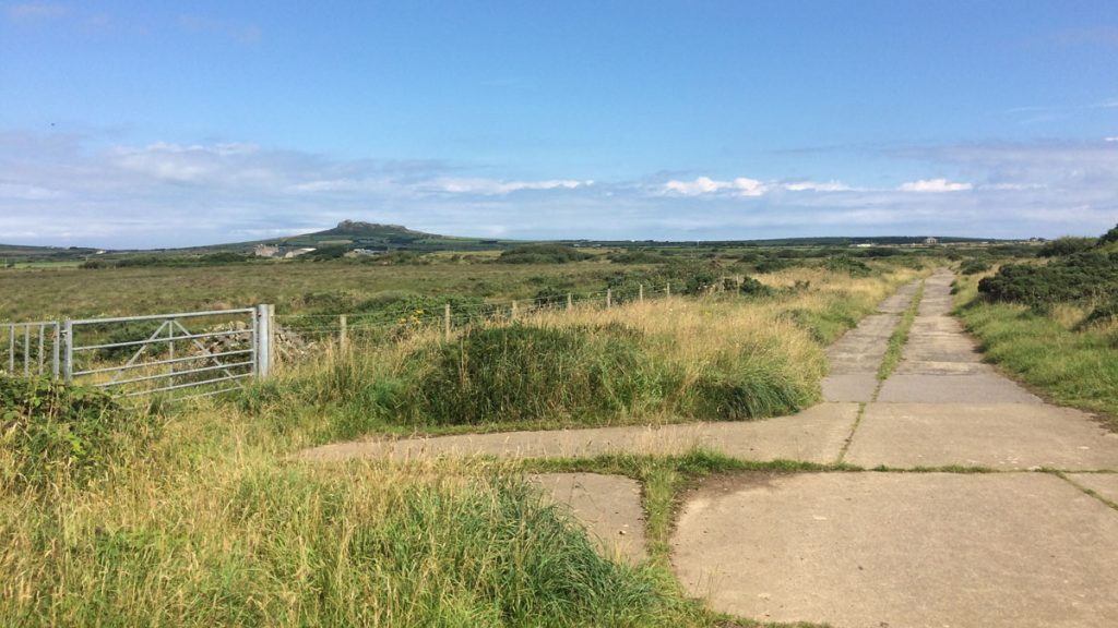 Concrete paths with grassy verge alongside (location pictured is St Davids Airfield)